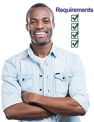 Successful and happy man. Handsome young black man keeping arms